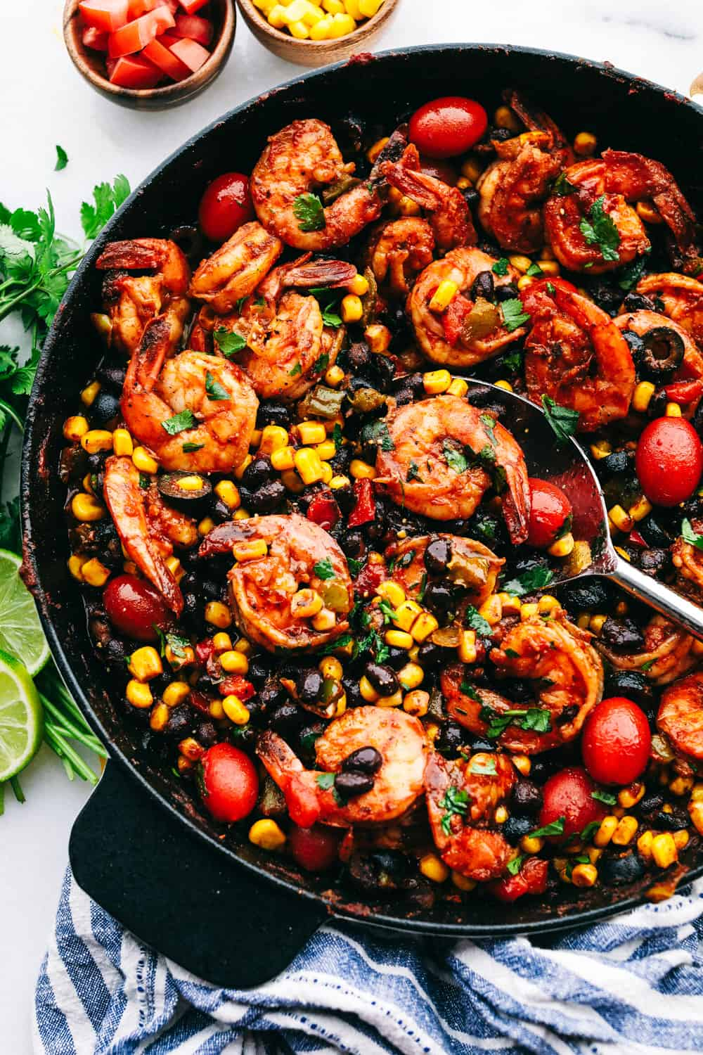 Mexican shrimp skillet in a skillet with a spoon.