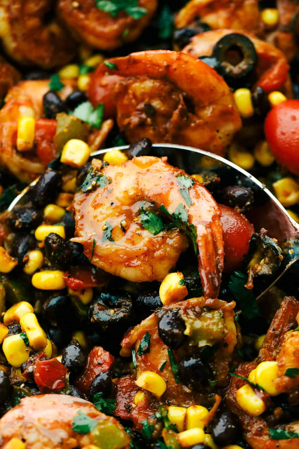 Mexican Shrimp Skillet with an up close photo with a spoon and shrimp on it.