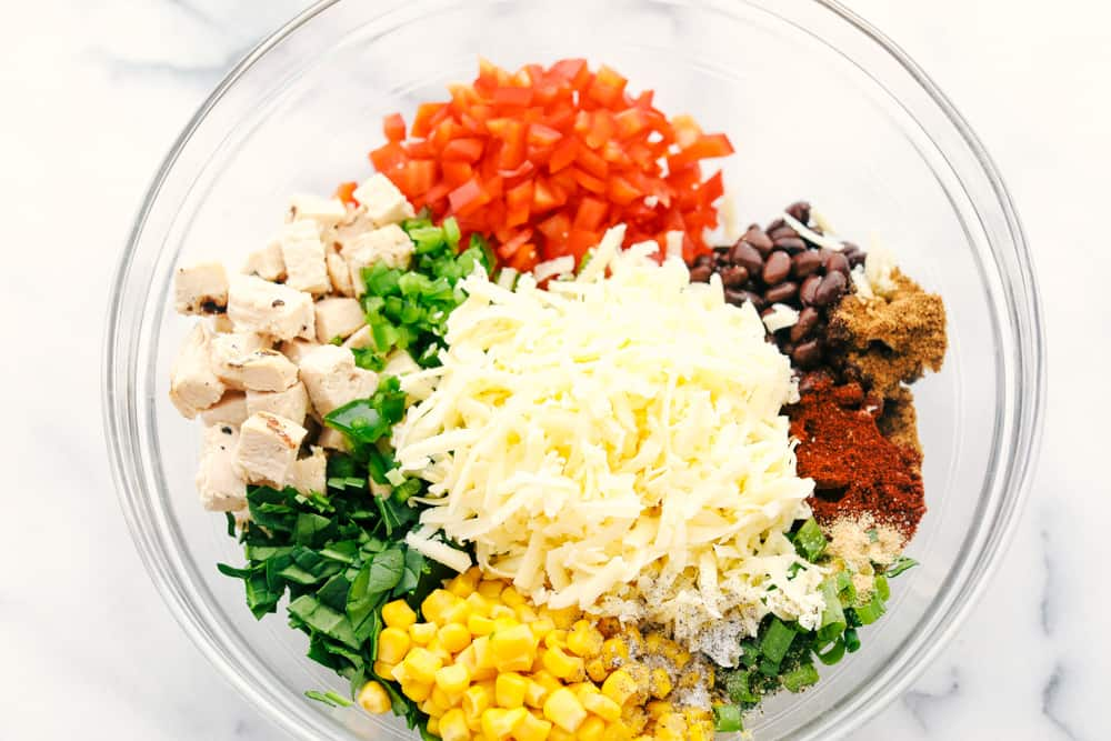 Chicken, bell pepper, black beans, cheese, seasoning and corn all in one bowl.