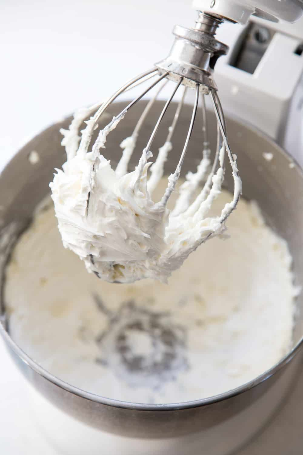 Vanilla buttercream frosting in a stand mixer bowl