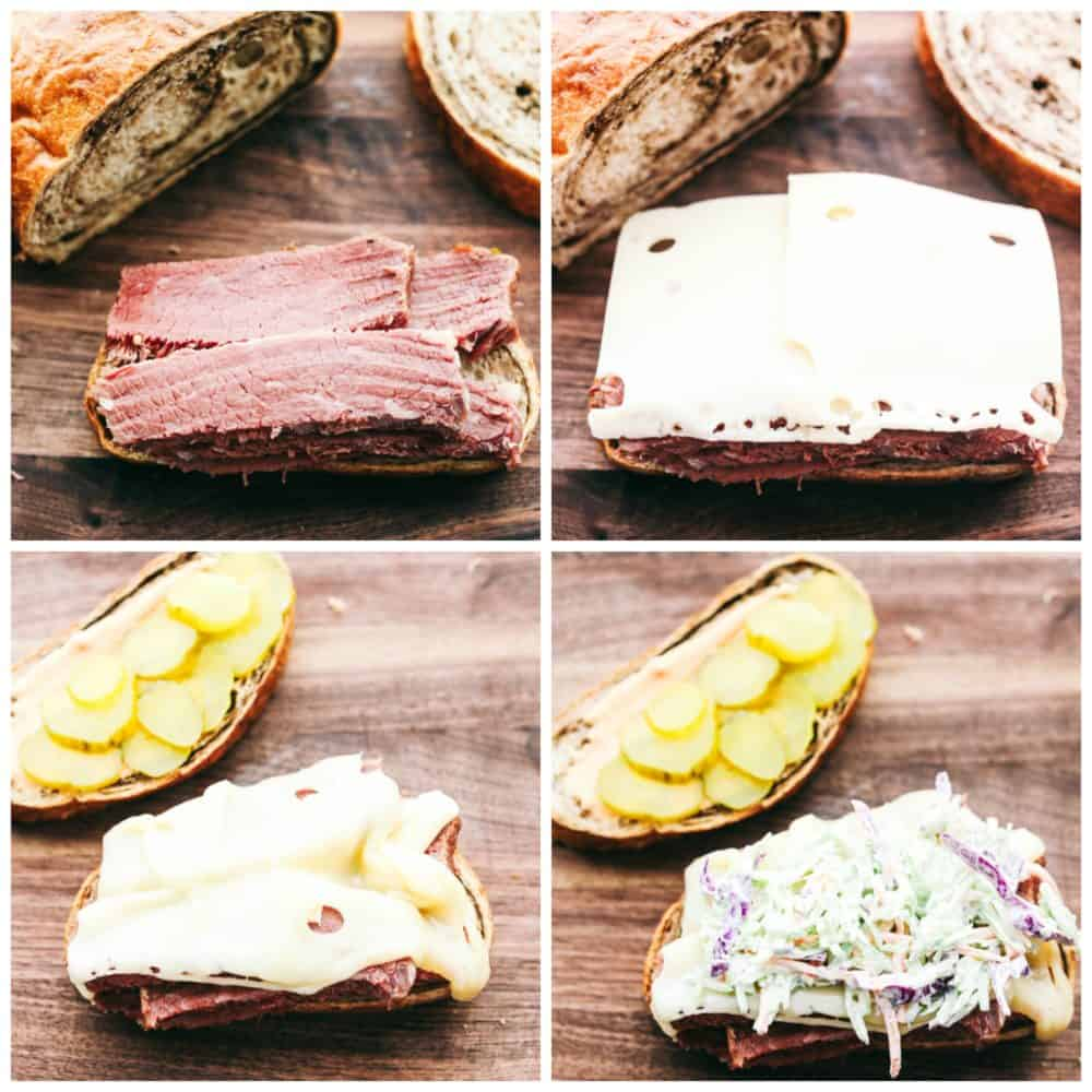 Making a corned beef sandwich with corned beef, cheese, pickles and coleslaw.