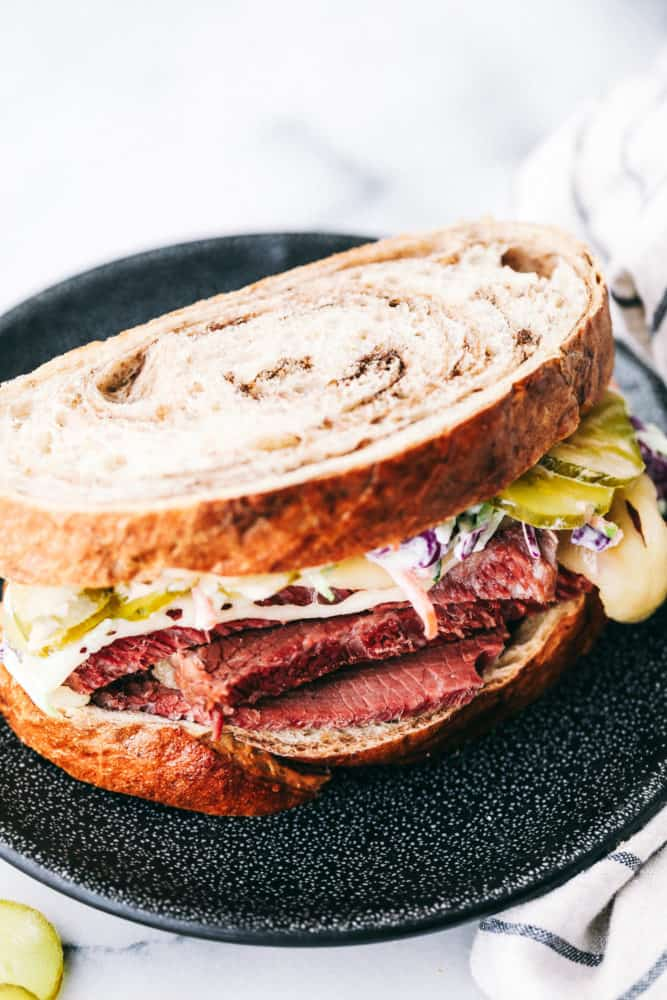 A corned beef sandwich on a plate.