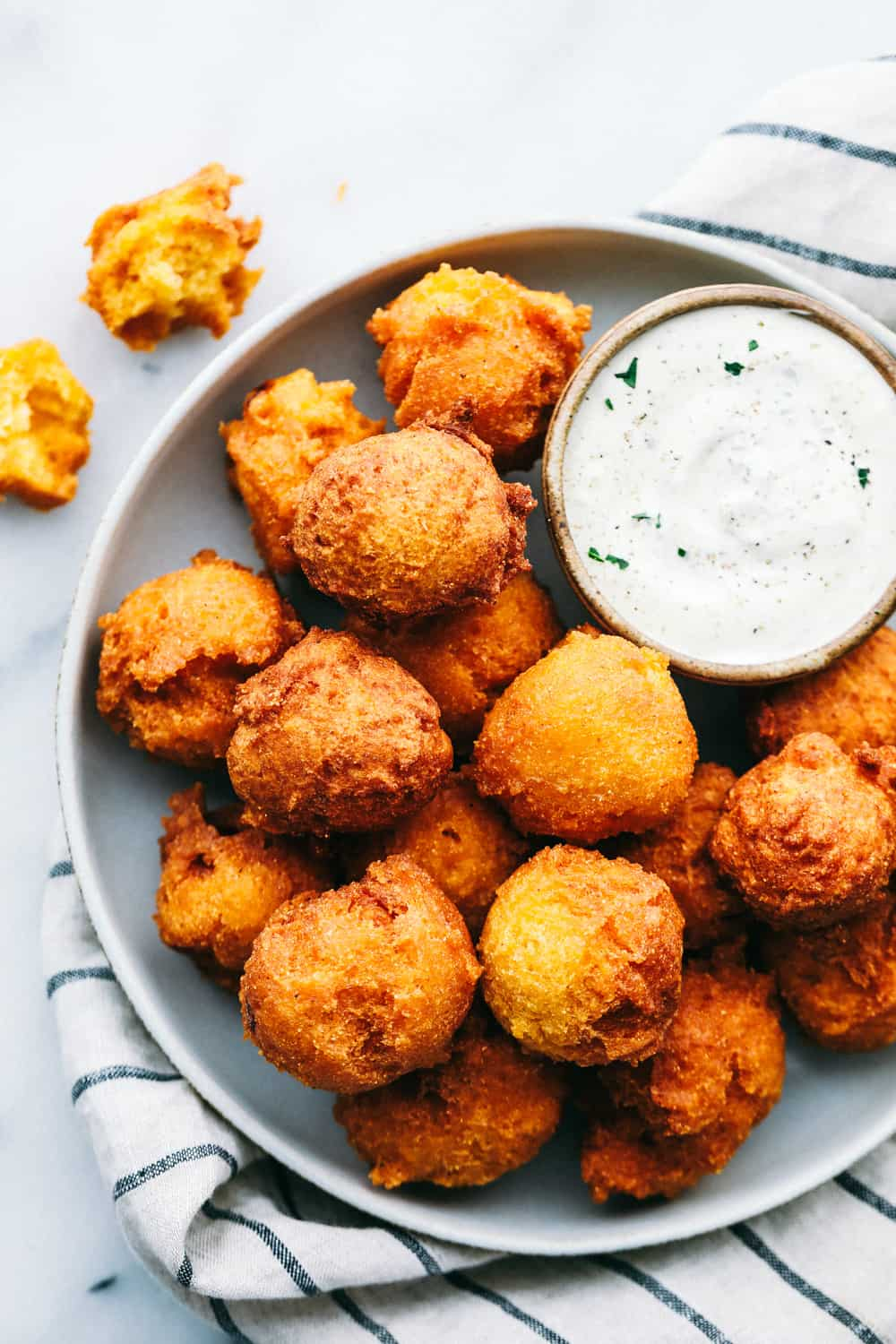 hush puppies on plate with dipping sauce