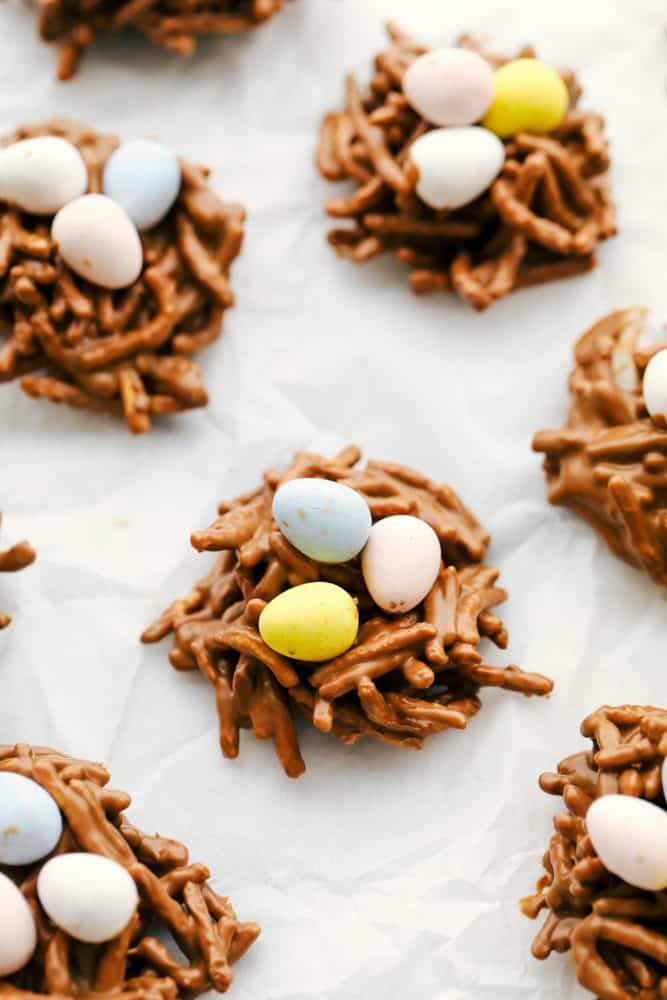 Birds nest on parchment paper with Cadbury eggs.