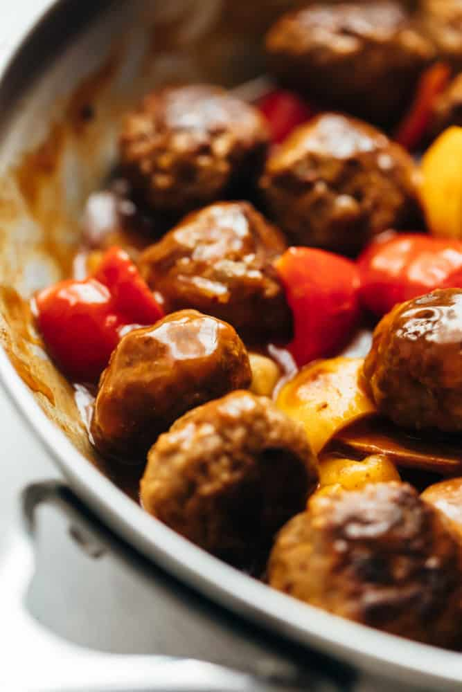 Closeup of Sweet and sour meatballs in a skillet