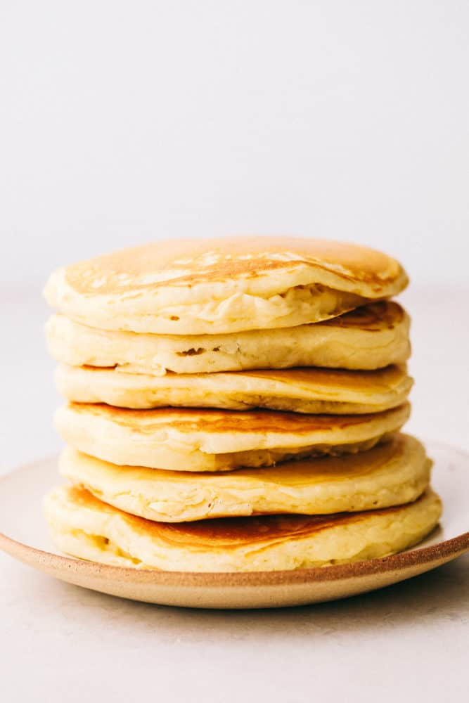 Fluffy pancakes stacked on top of each other.