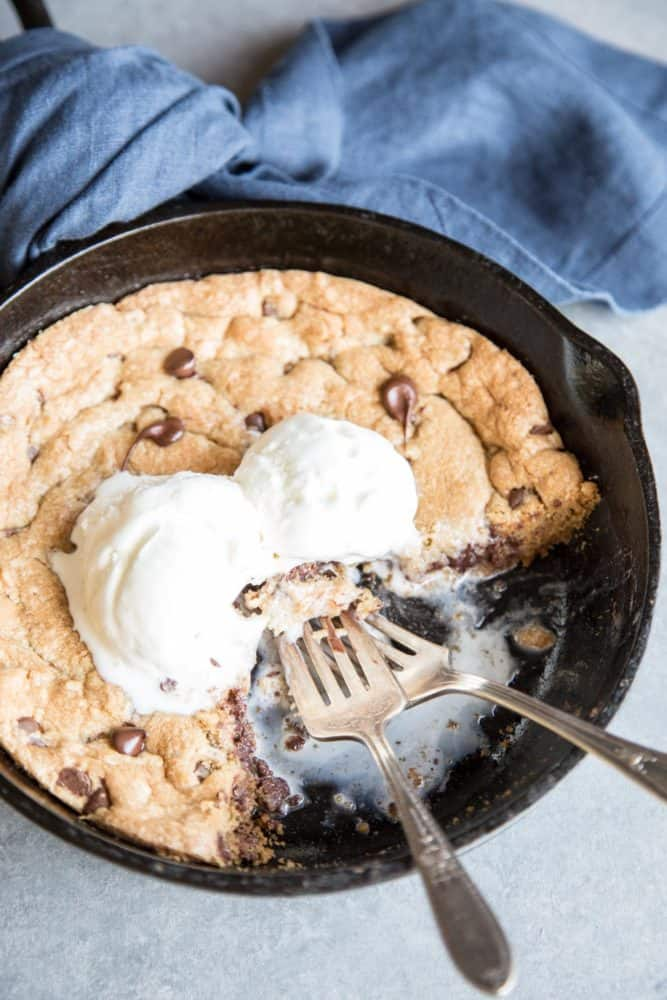 Pizookie with ice cream in a cast iron skillet
