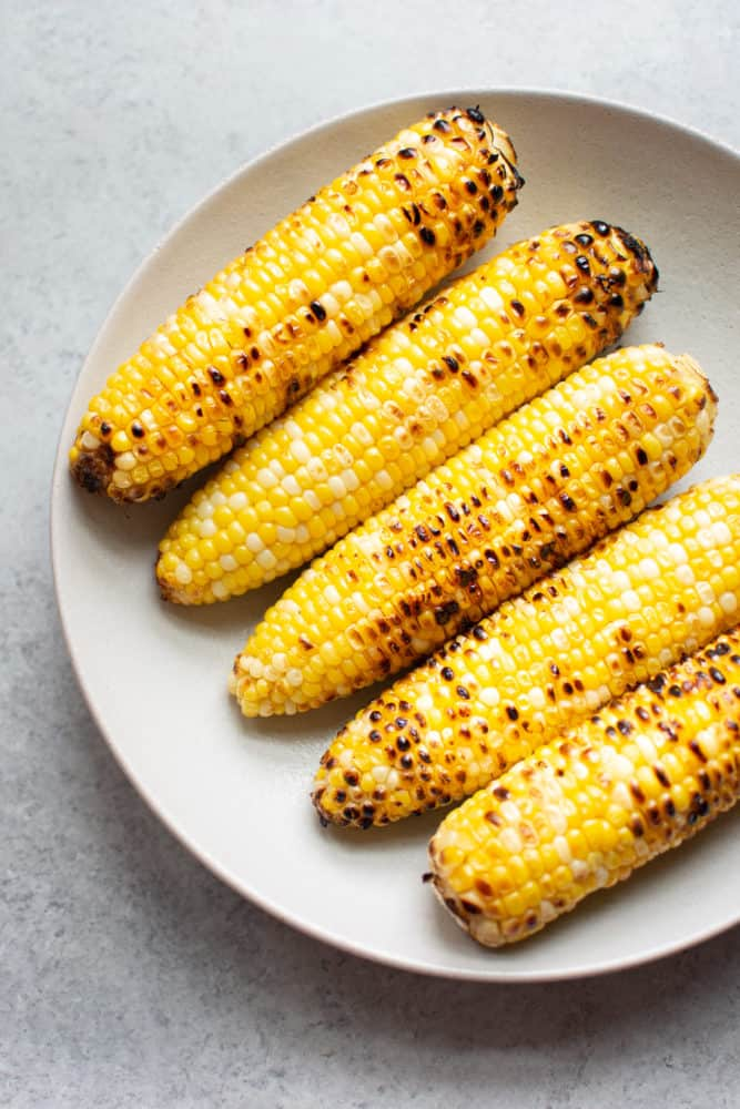 Grilled corn on the cob in a bowl
