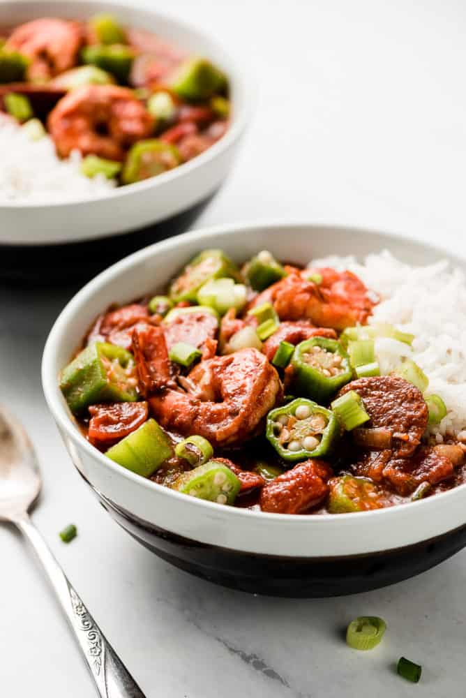 A bowl of shrimp, sausage, and okra gumbo over rice.