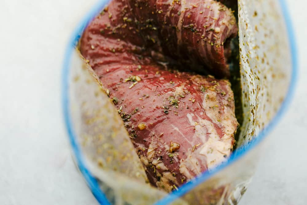 Ziplock bag with flank steak and marinate.