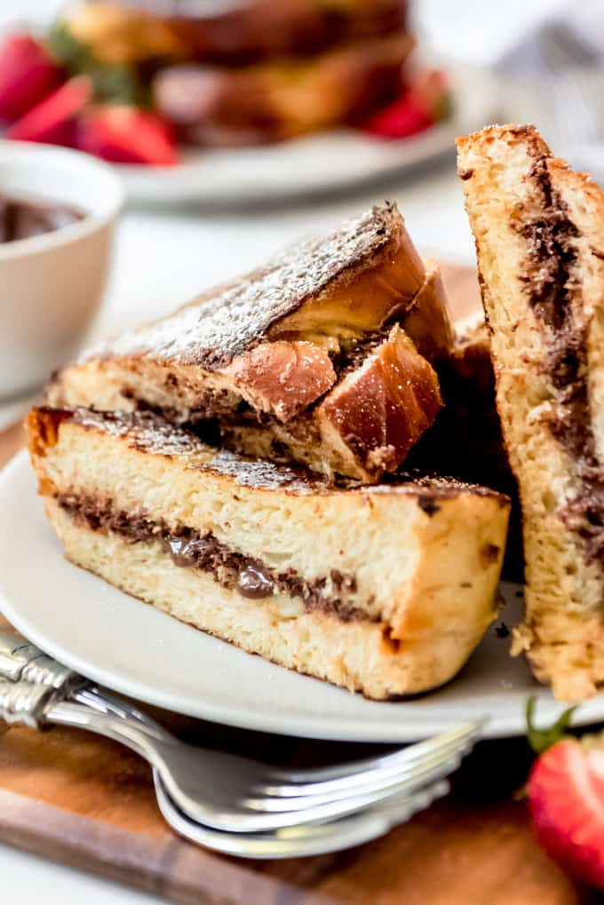 An image of a piece of french toast stuffed with Nutella on a plate.