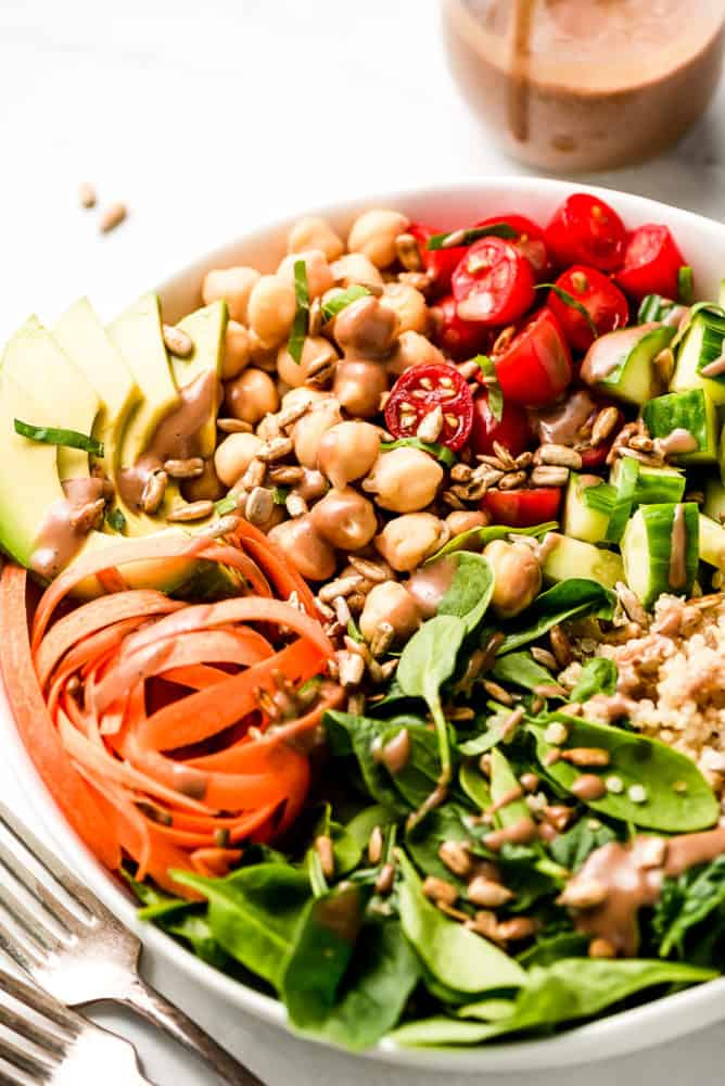 A close up shot of chickpeas and vegetables in a bowl.