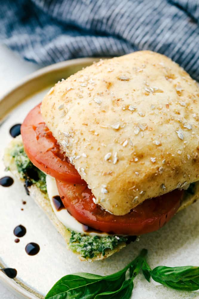 A finished caprese sandwich on a plate.