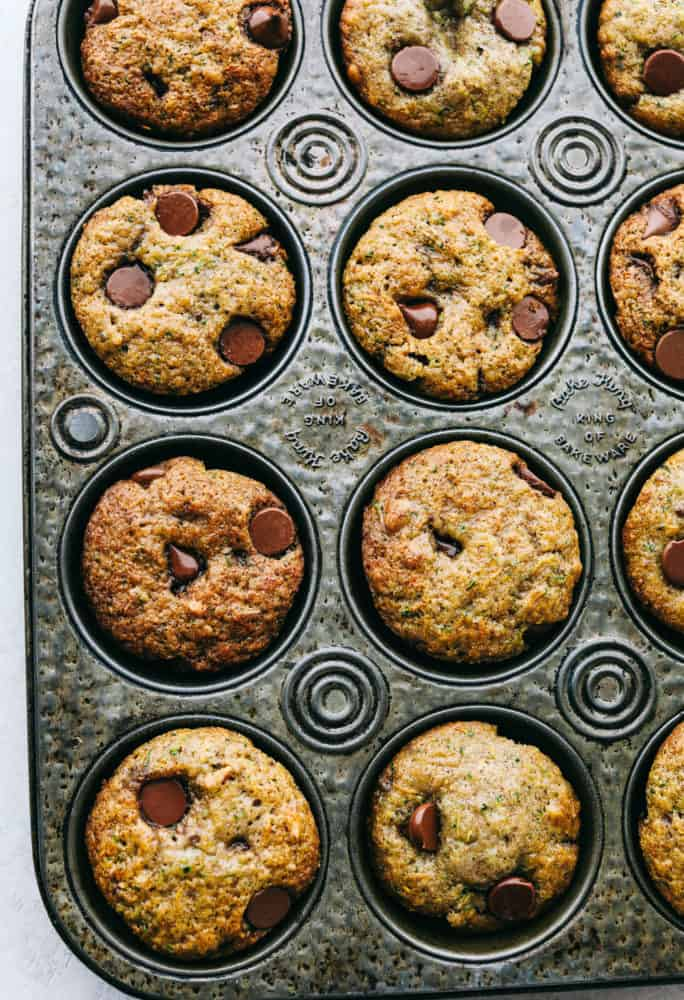 Chocolate chip zucchini muffins in a baking pan.
