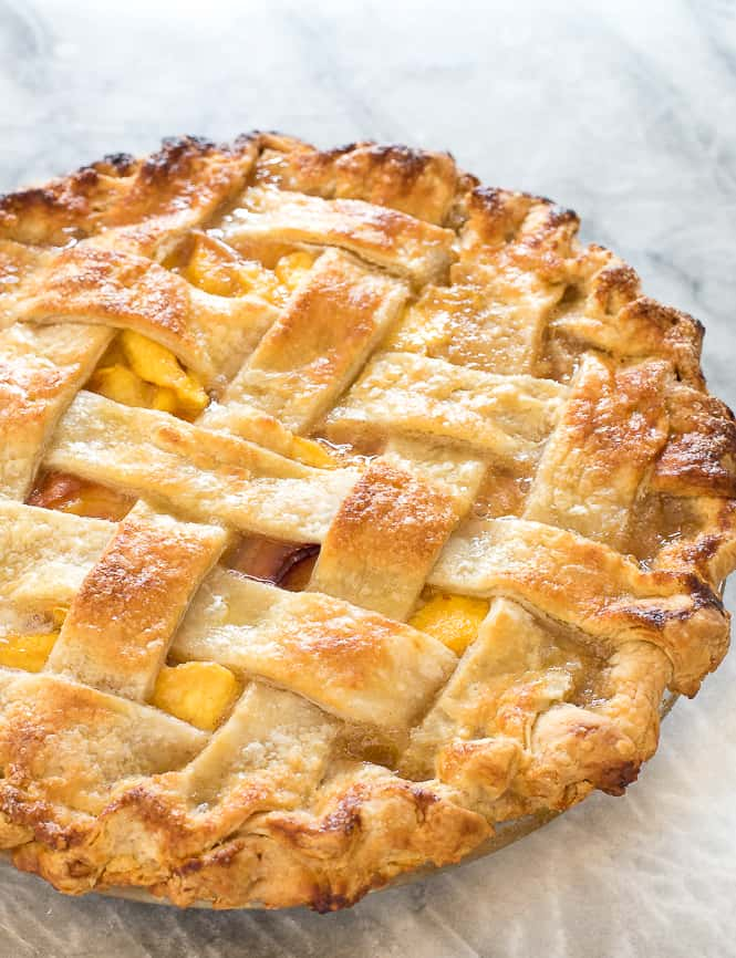 Homemade Peach Pie baked with a lattice top.