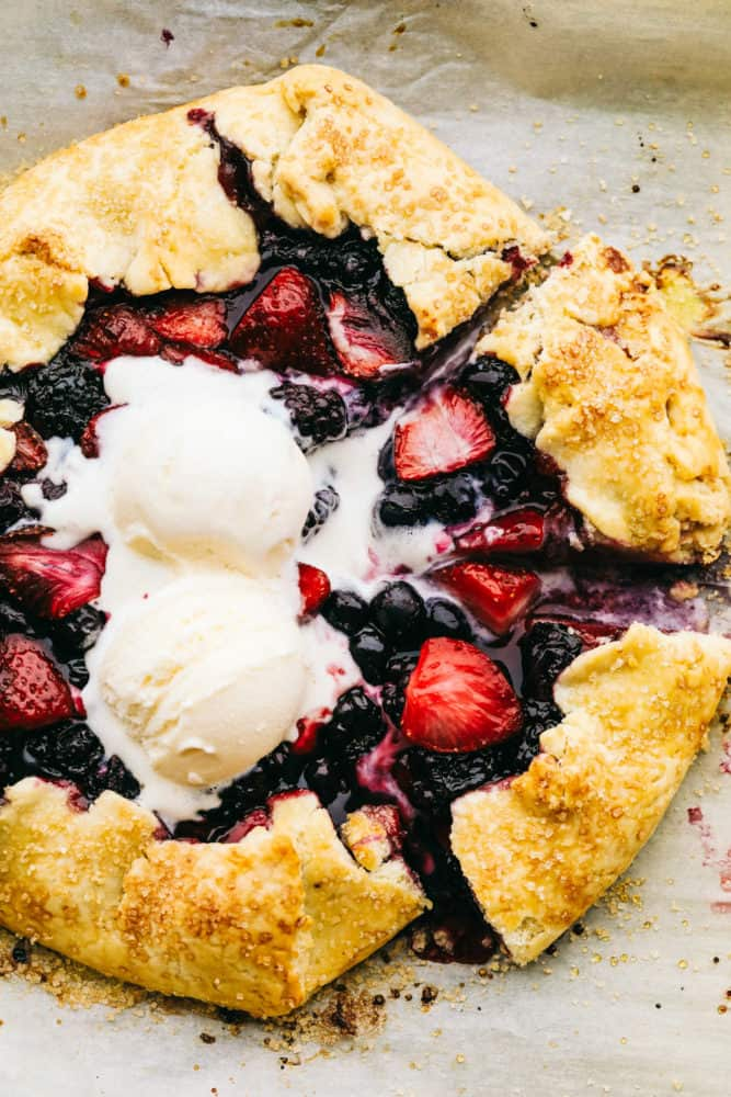 Finished Berry galette with two scoops of vanilla ice cream on top.