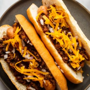Closeup of chili dogs on a plate