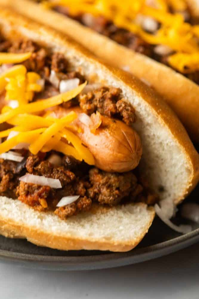 Super closeup of chili dogs on a plate