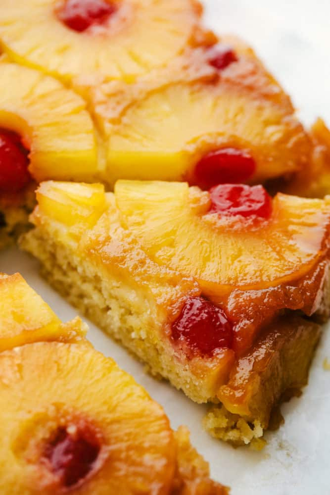 Close up on a slice of pineapple upside down cake.