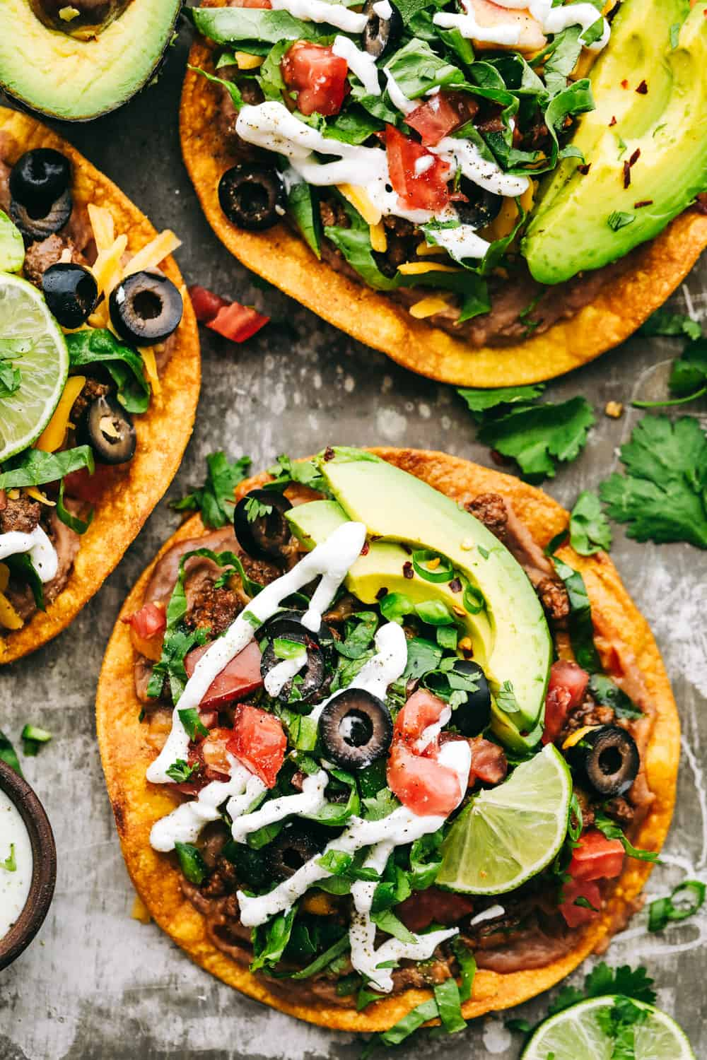 Three tostadas layered with optional toppings.