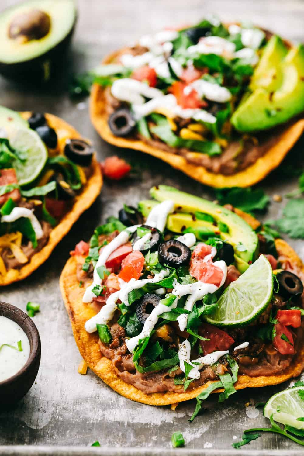Tostadas with layers of optional toppings.