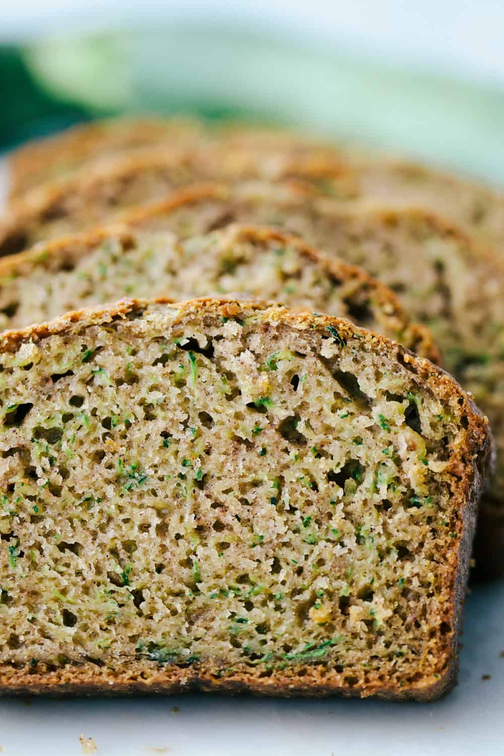 Photo facing the zucchini bread sliced and laying back.