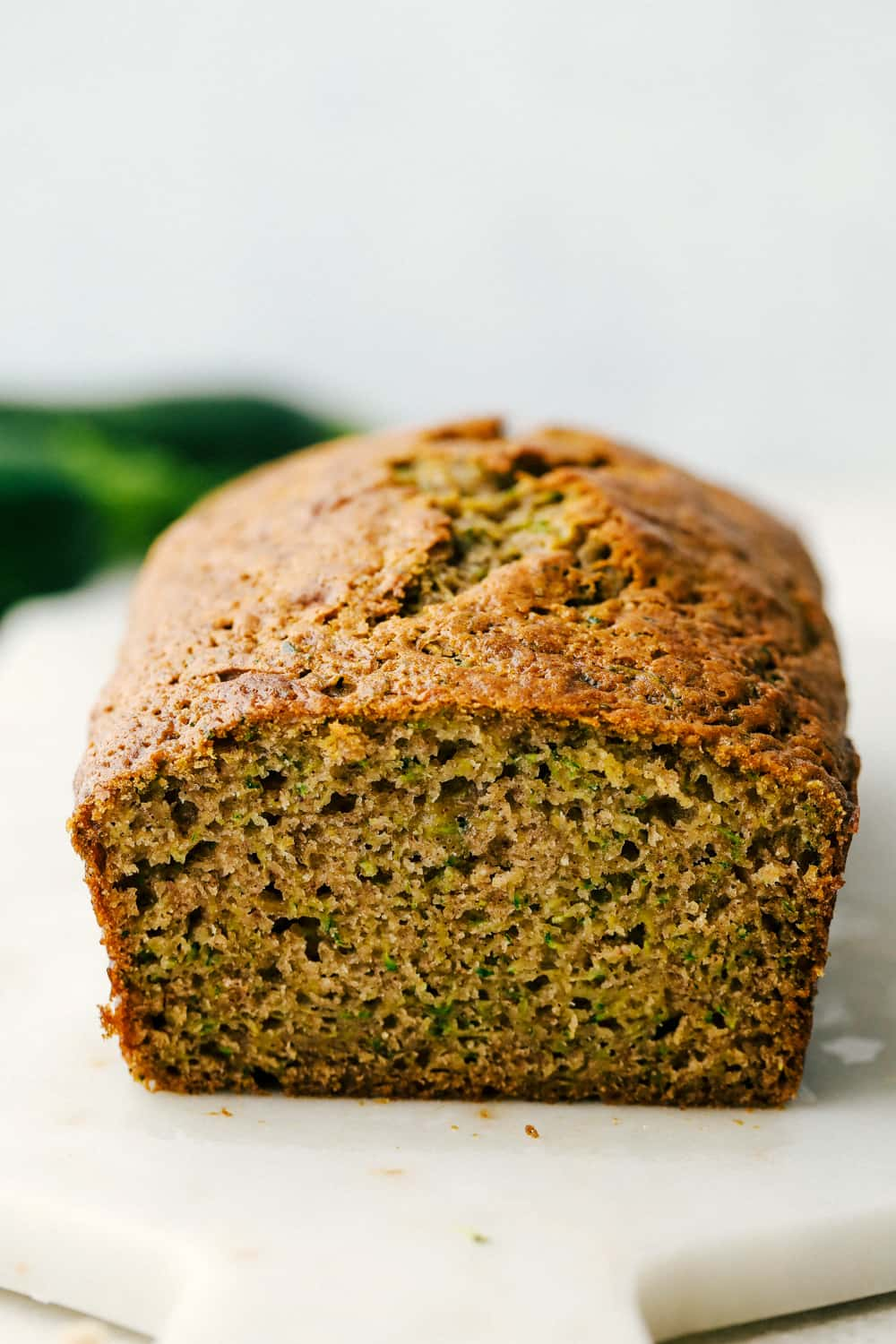Zucchini bread facing out with the bread sliced.