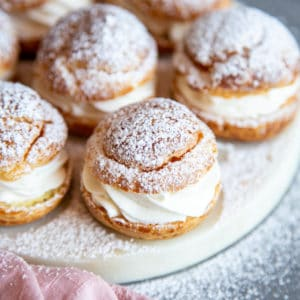 Cream puffs on a serving plate