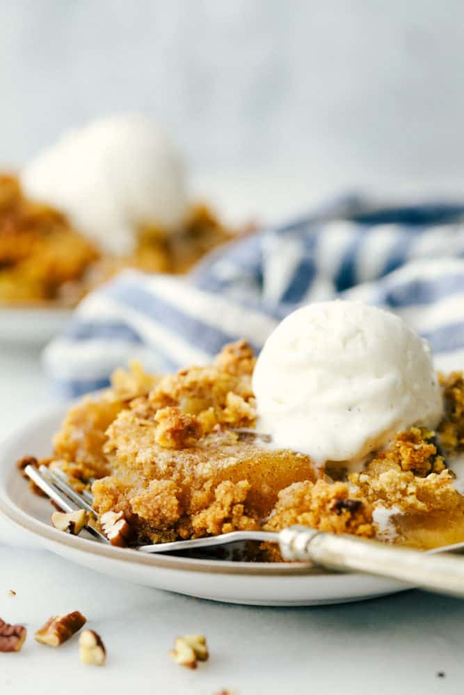 Apple dump cake on a plate with a fork.