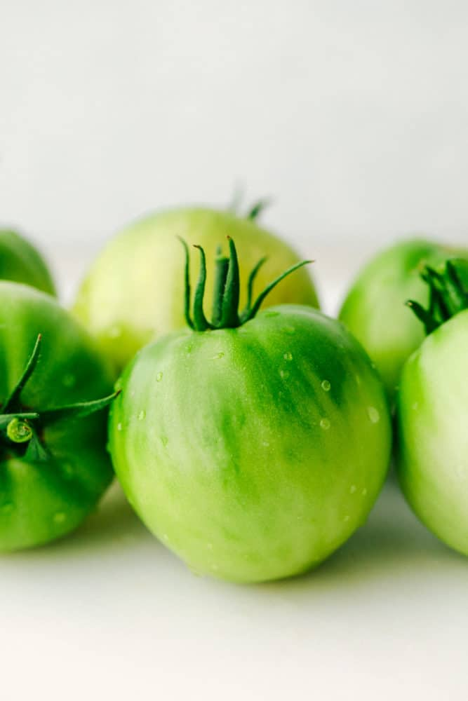 Green tomatoes close up.
