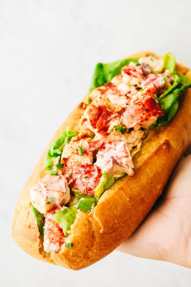 Holding a finished lobster roll.