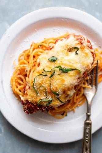 Chicken Parmesan served over spaghetti