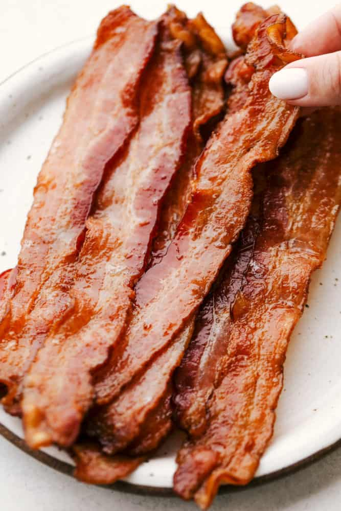 Crispy baked bacon on a plate.