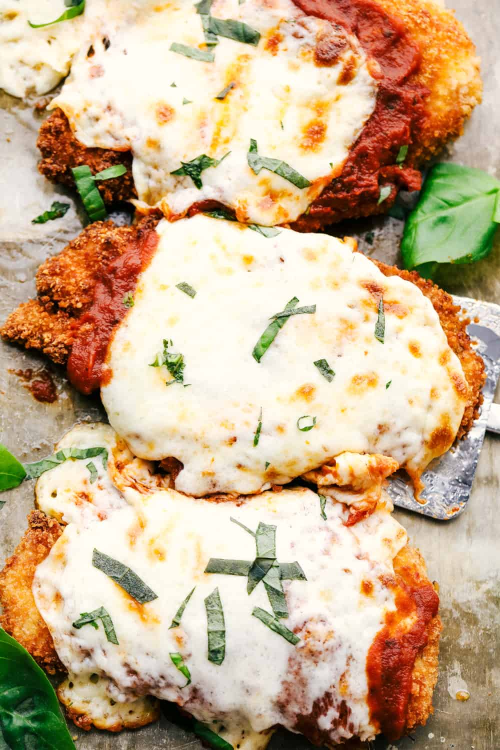 Chicken parmesan with marinara and melted cheese.