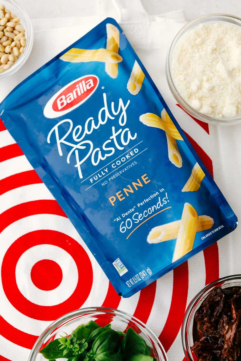 Barilla Ready Pasta laying on its back over top a target bag.