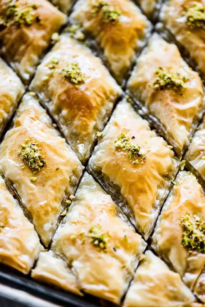 Diamonds of baklava stopped with minced pistachios.