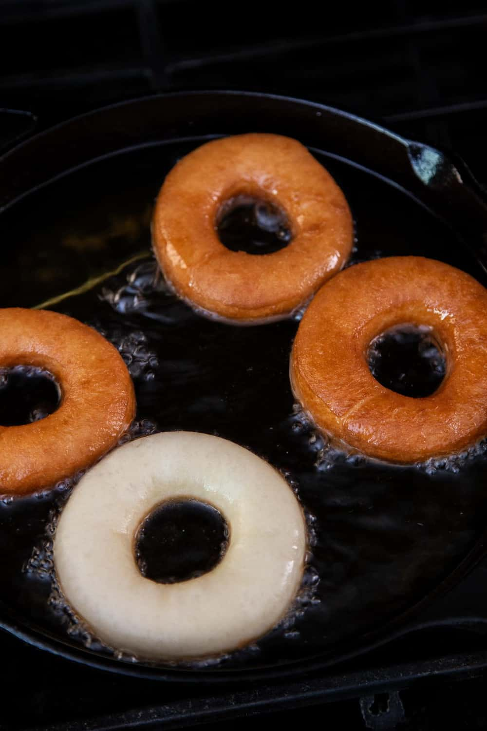 Frying donuts in a cast iron pan