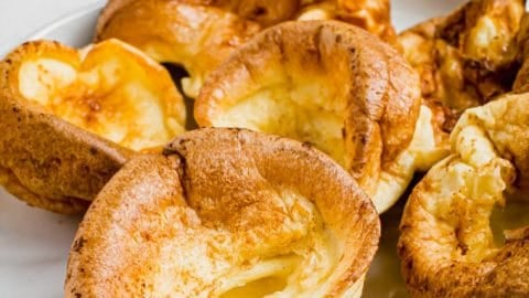 Individual Yorkshire pudding on a white plate.