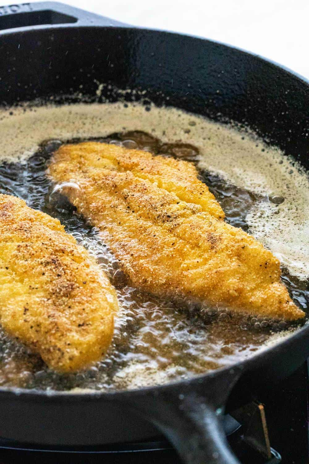 frying fish in a cast iron skillet