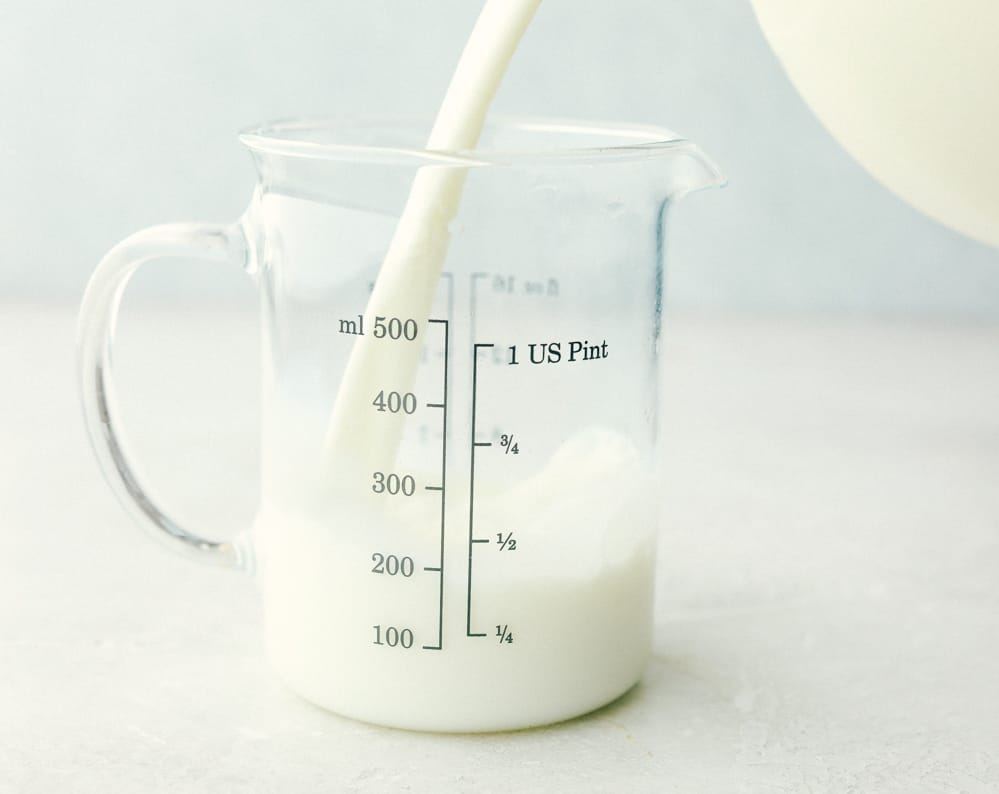 Measuring milk for homemade buttermilk.