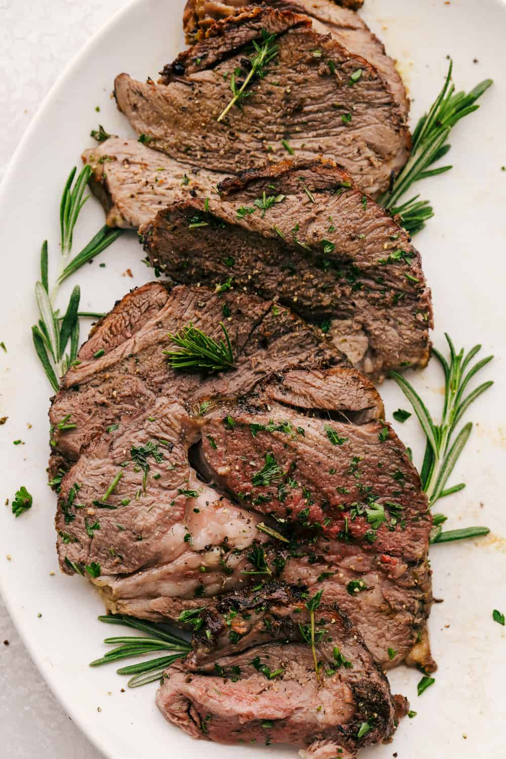 Roasted Garlic Herb Crusted Lamb on a platter.