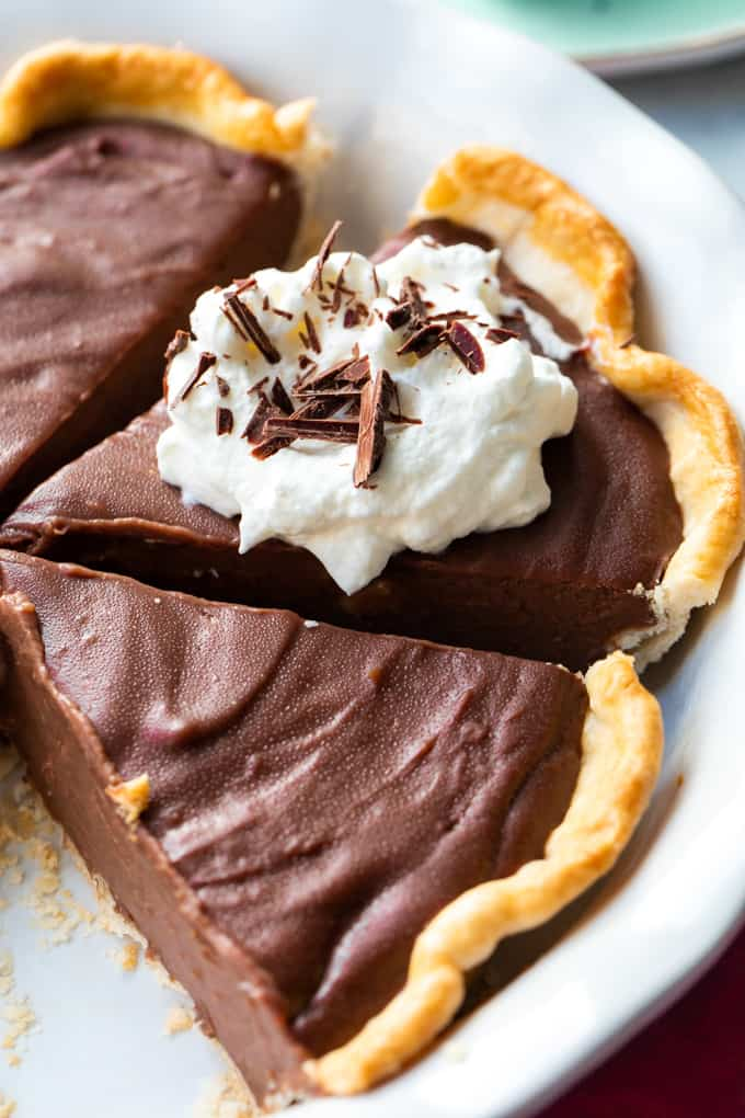 Chocolate pie sliced in a pie plate.