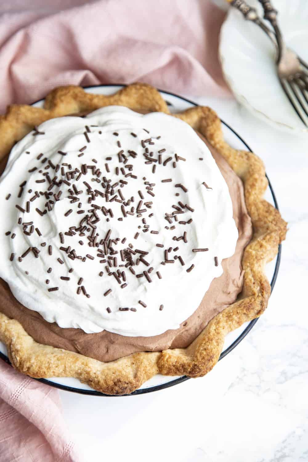 French Silk pie with whipped topping and chocolate sprinkles.