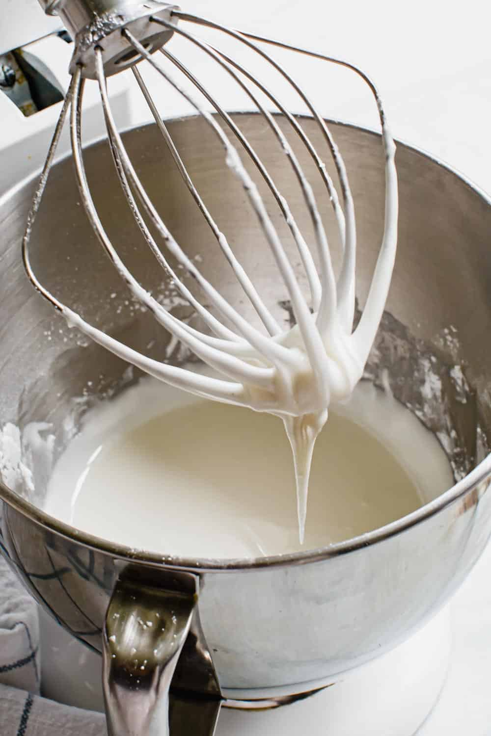 Royal icing in an electric mixing bowl.