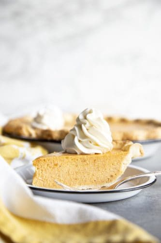 A slice of sweet potato pie on a plate