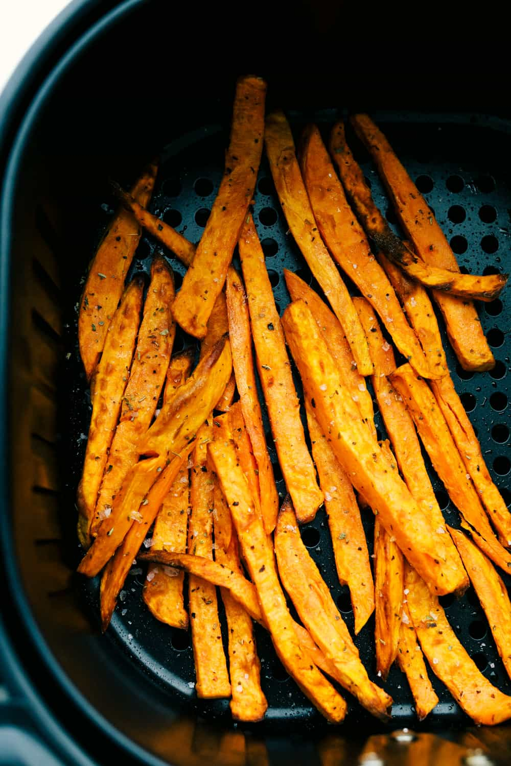 Sweet potato air fryer fries with seasonings.