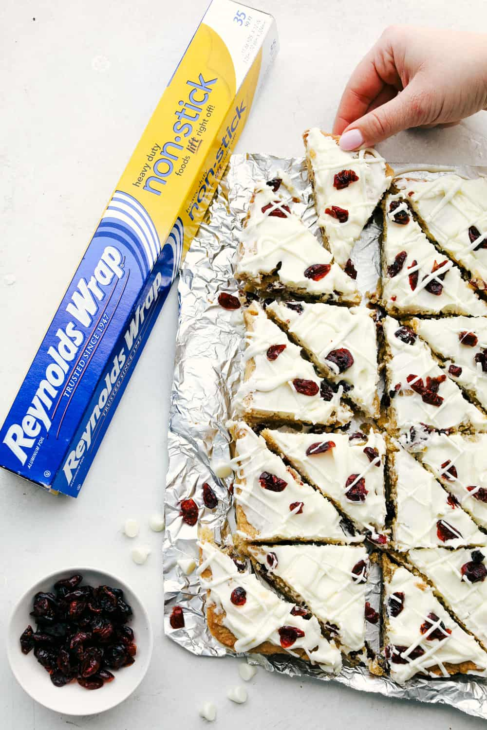 Cranberry bliss bars cut into triangles.