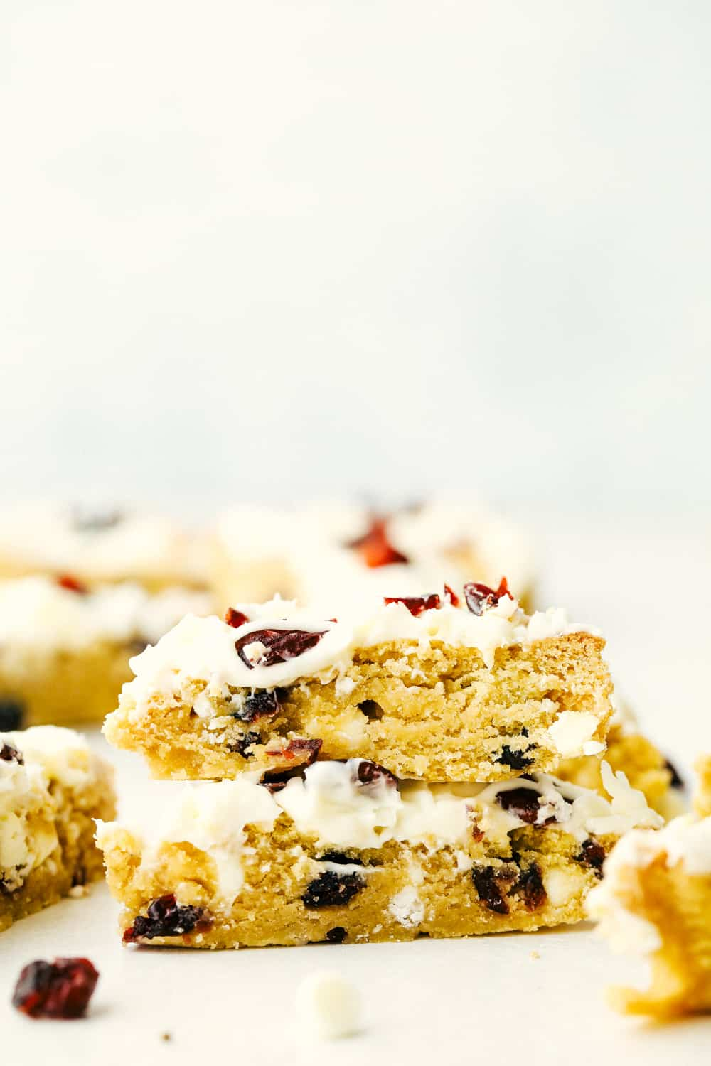 Cranberry bliss bars stacked on top of each other.