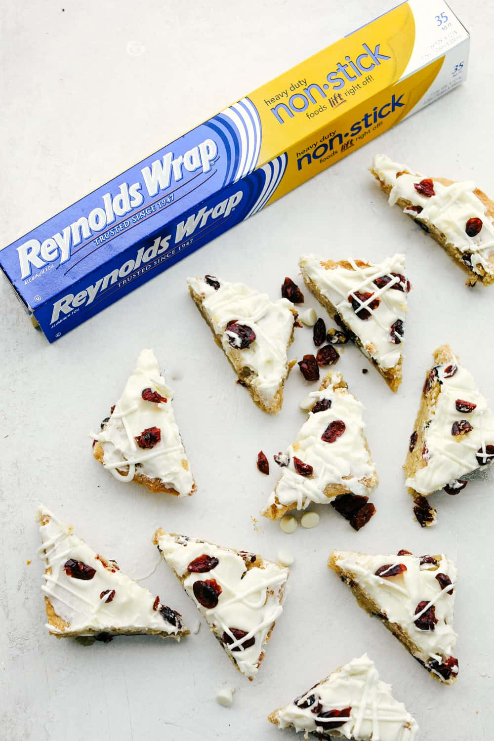 Cranberry bliss bars cut into triangles spread apart.
