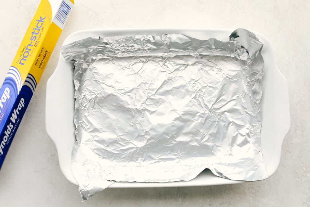 Reynolds Wrap covering a white baking dish.
